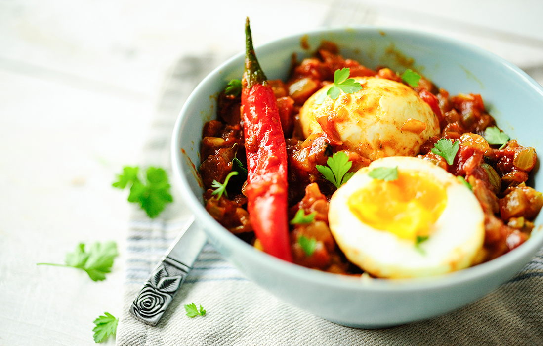 serving dumplings | Eggs in tomato curry sauce
