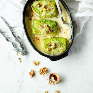 Potato, chicory and pear stuffed cabbage with gorgonzola sauce