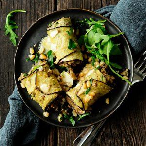 Aubergine rolls with asparagus and quinoa