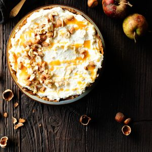 Caramel apple pie with whipped cream and meringue
