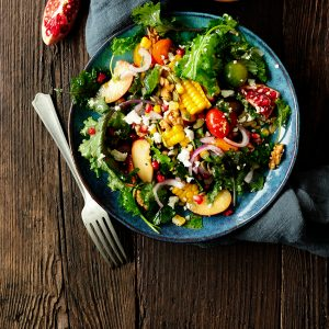 Very juicy kale salad with plums