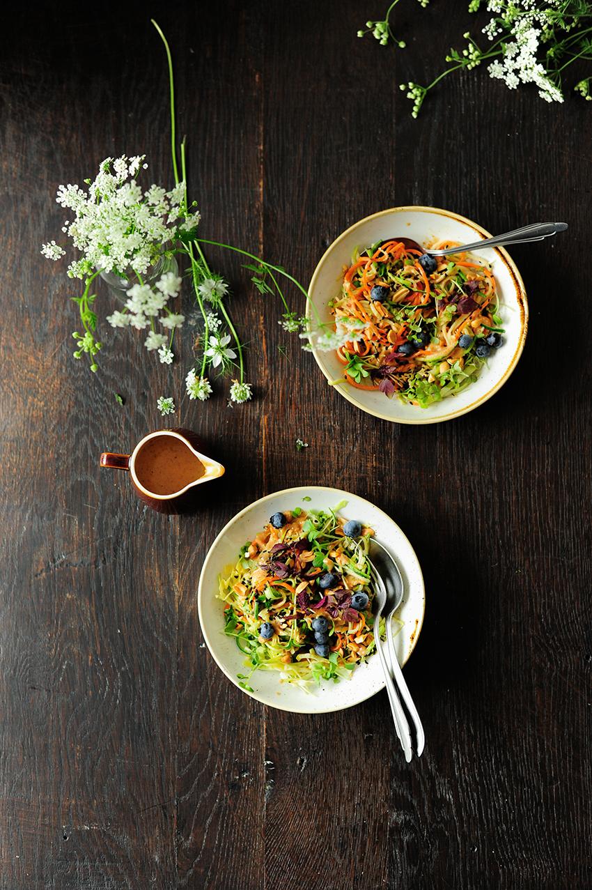 serving dumplings | Tahini peanut zucchini noodle bowl