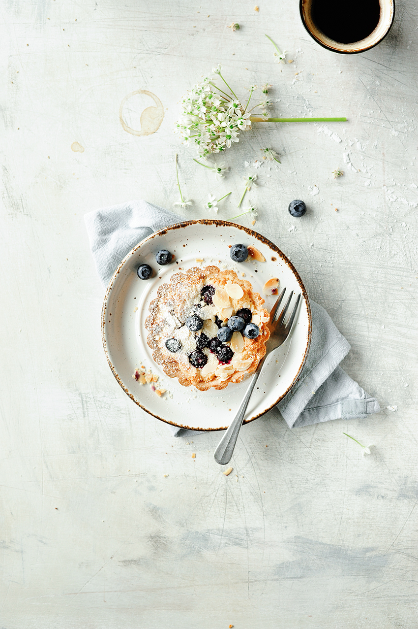 serving dumplings | Almond tarts with blueberries