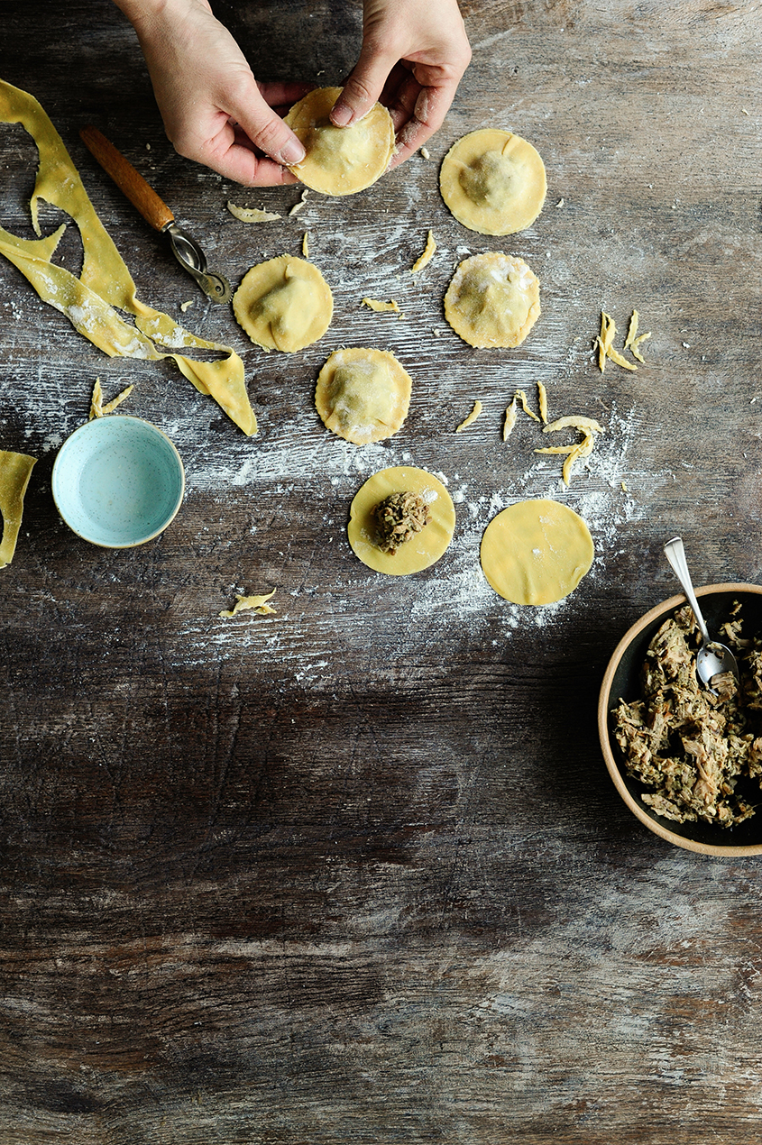 serving dumplings | Pulled chicken ravioli with sautéed chanterelles