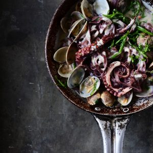 Creamy garlic black pasta with clams and octopus