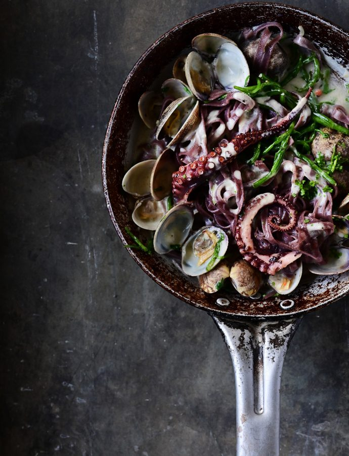 Creamy garlic black pasta with clams and squid