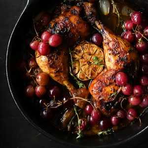 Roast chicken legs with garlic and grapes