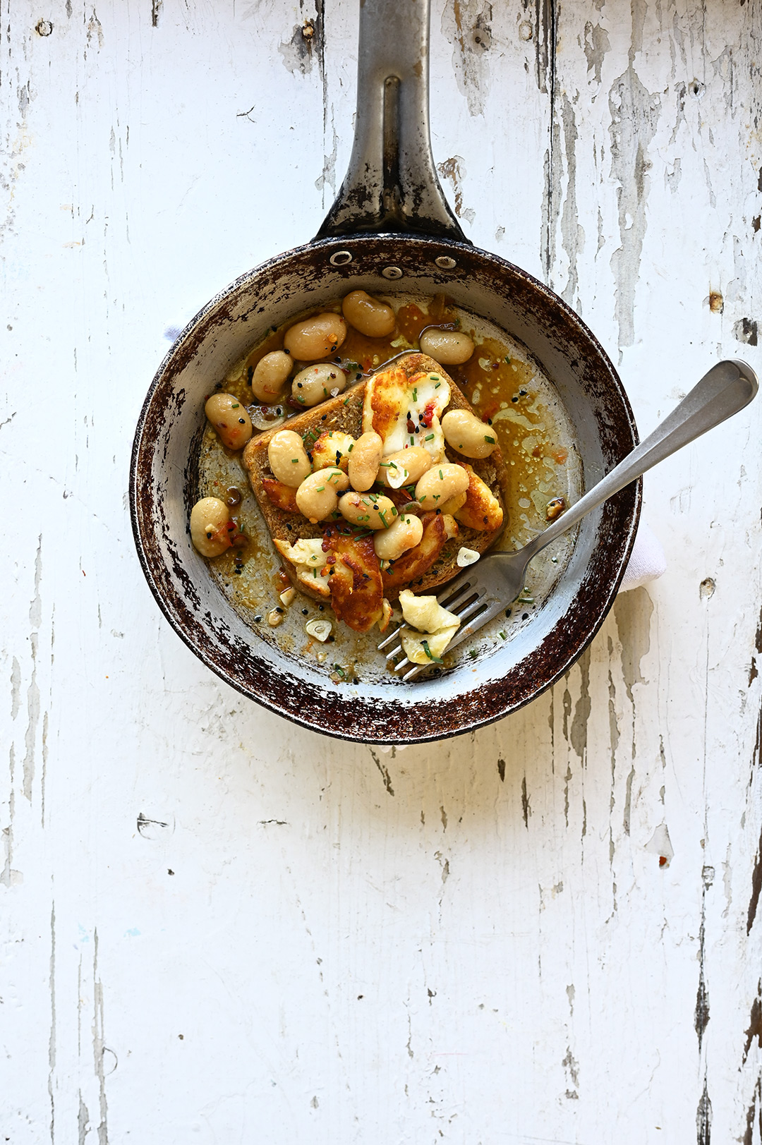serving dumplings | Spicy miso white beans with halloumi and toast