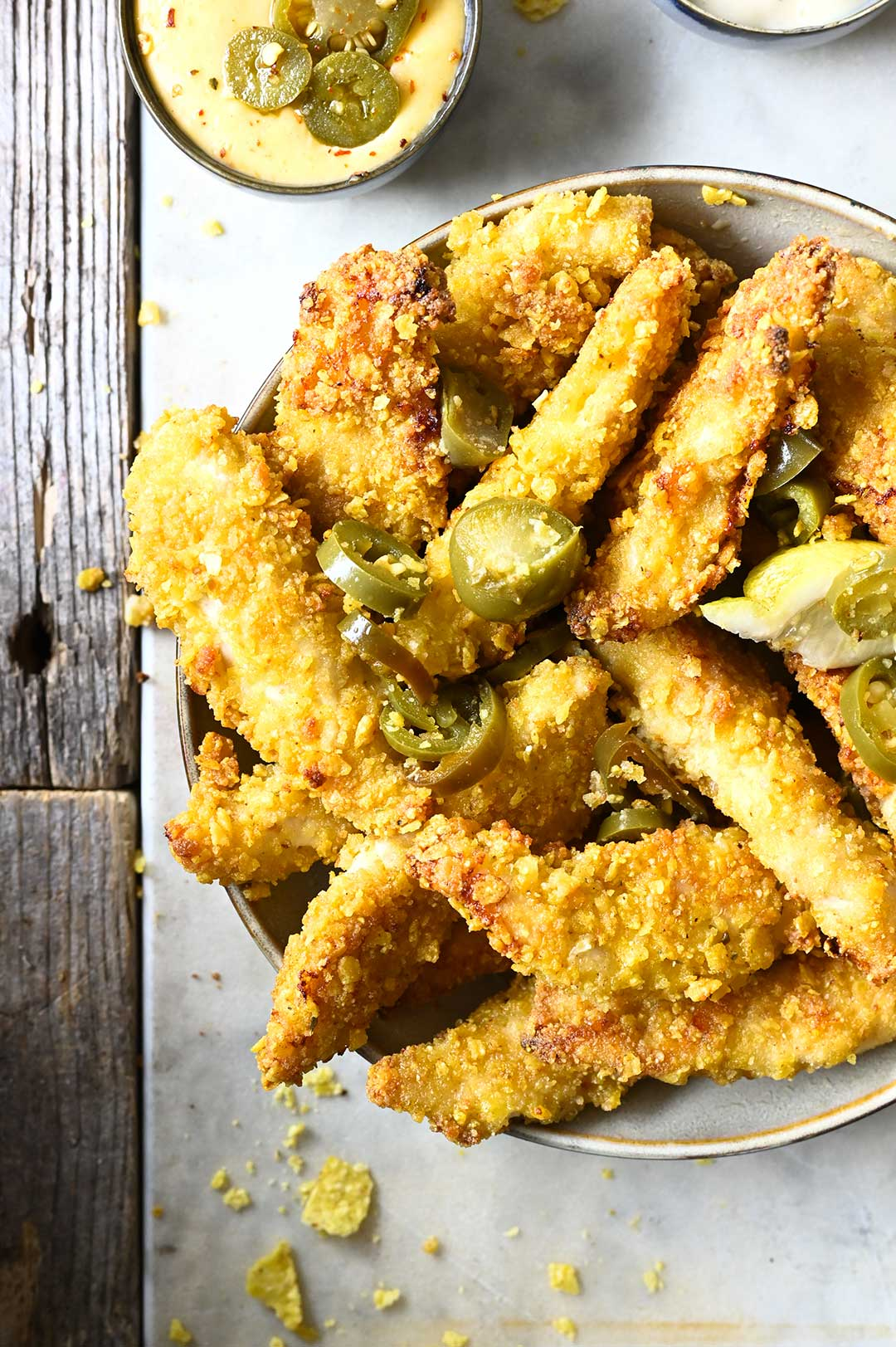 serving dumplings | Corn chips crusted chicken fingers with jalapeño aïoli