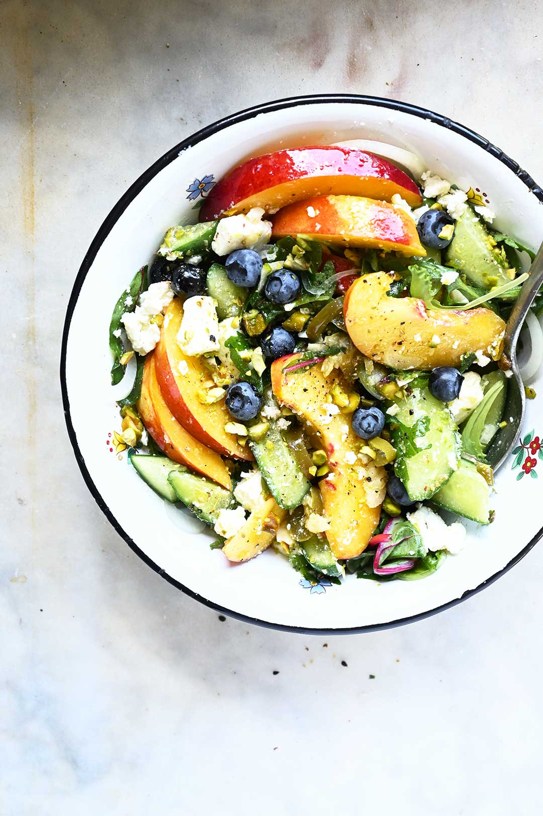 serving dumplings | Cucumber nectarine salad with feta and jalapeños