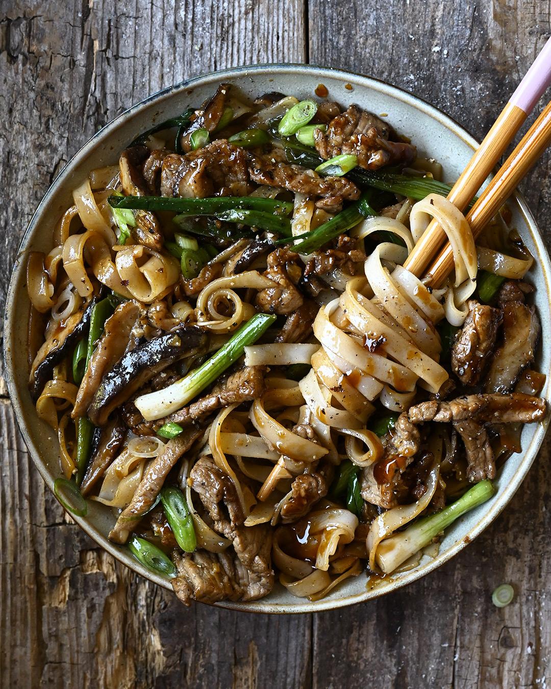 20 Minute Beef And Shiitake Noodle Stir Fry Serving Dumplings