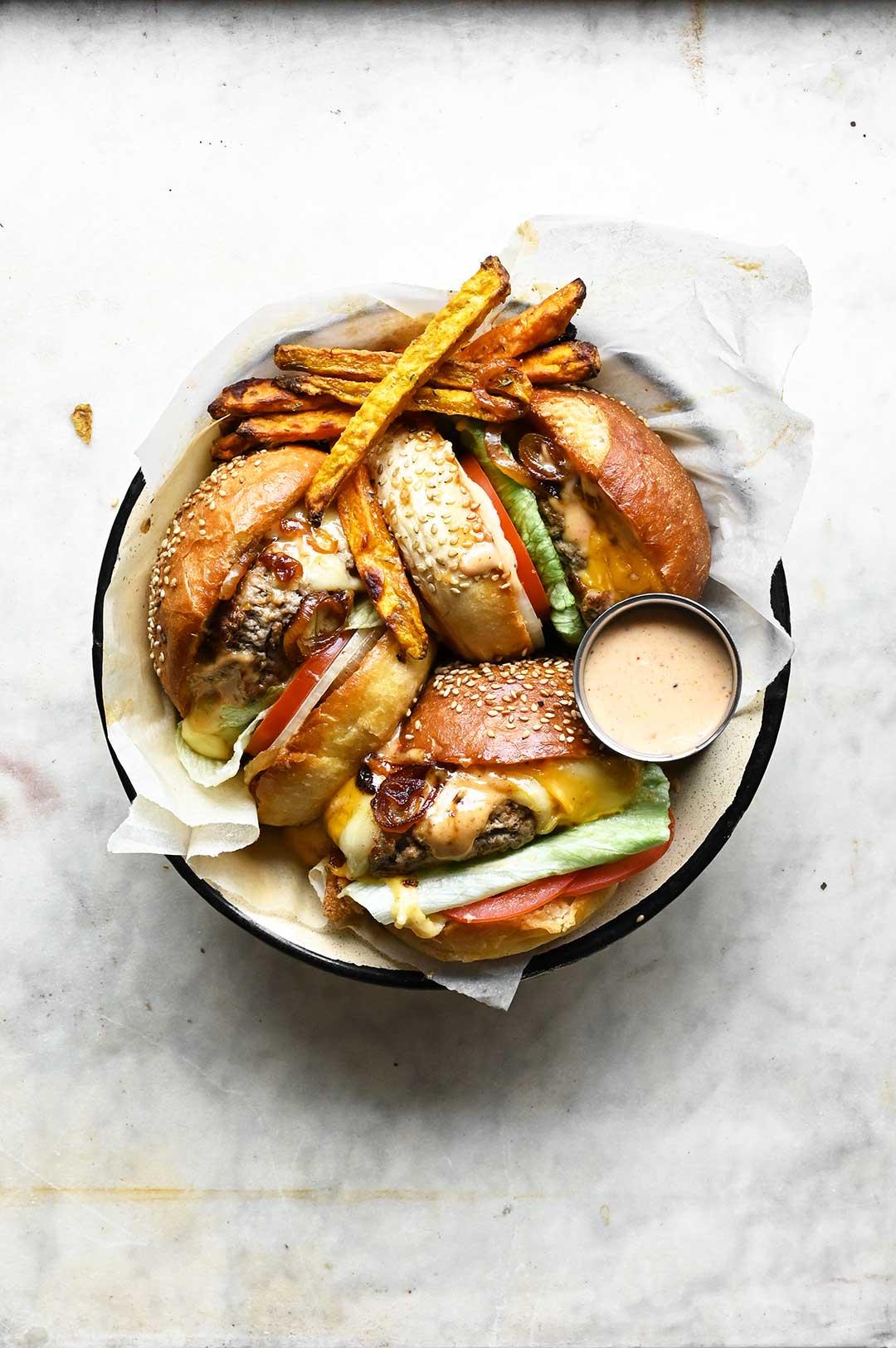 serving dumplings | Juicy cheeseburger with jalapeño sauce and sweet potato fries
